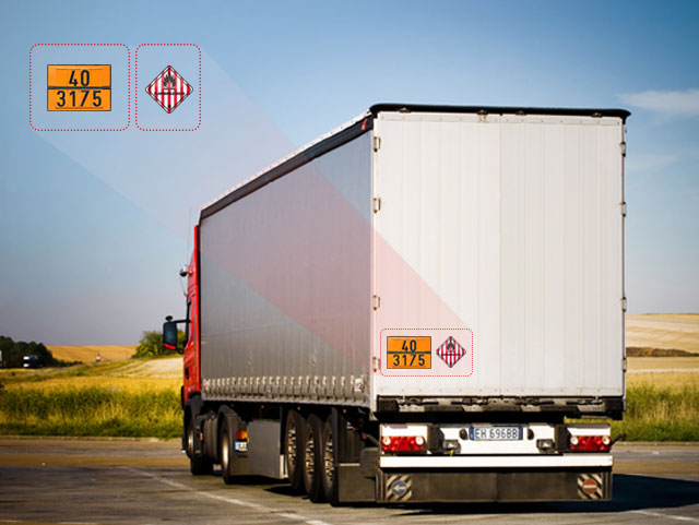 Truck With Hazmat Cargo Indicated by ADR and IMDG Signs